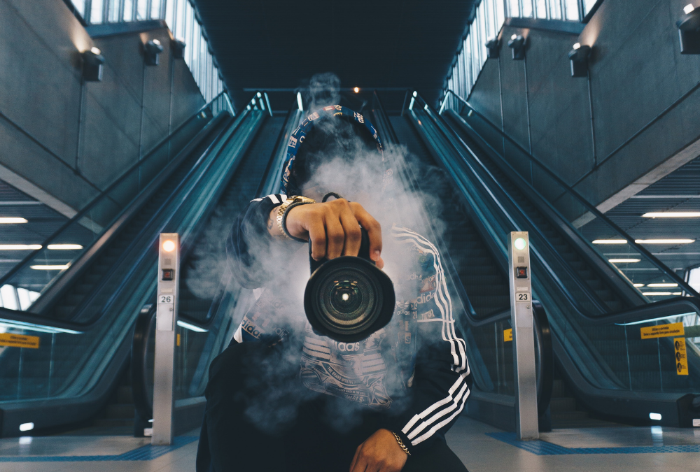 Camera with Smoke and Background Escalators